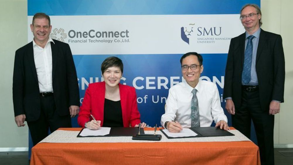 Signing the MOU at SMU today were (seated L-R) Ms Tan Bin Ru, CEO (Southeast Asia) at OneConnect and Professor Pang Hwee Hwa, Dean of SMU School of Information Systems. The signing was witnessed by (standing L-R) Dr Corey Manders, Head of Research and Development at OneConnect Financial Technology and Associate Professor Paul Griffin from SMU School of Information Systems.