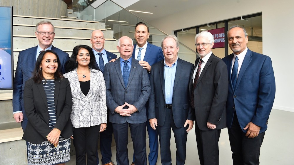 From L-R: Surrey-Green Timbers MLA Rachna Singh, Bruce Ralston, B.C. Minister of Jobs, Trade and Technology, Anita Huberman, CEO, Surrey Board of Trade, Premier John Horgan, Surrey-Guilford MLA Garry Begg, Surrey-Fleetwood MLA Jagrup Brar, Surrey Mayor Doug McCallum, SFU President Andrew Petter and Harry Bains, Minister of Labour. Photo: Greg Ehlers