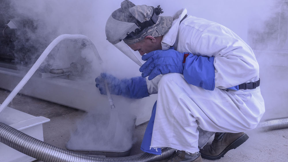 Airman 1st Class Nathanael Markley, 36th Logistics Readiness Squadron cryogenics lab technician, releases gaseous liquid oxygen into a beaker on Andersen Air Force Base, Guam. The 36th LRS cryogenics production technician team is one of two base-level cryogenics teams left in the Air Force that still makes all of its own products. (U.S. Air Force photo by Airman 1st Class Adarius Petty)