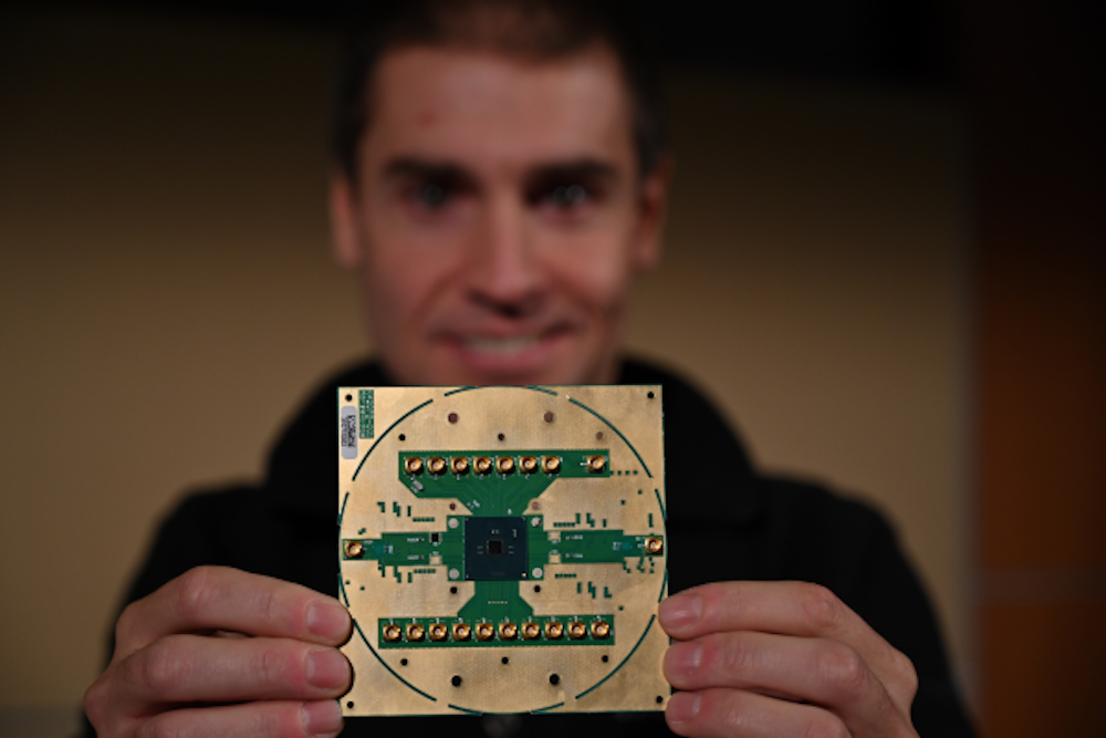 Stefano Pellerano, principal engineer at Intel Labs, holds Horse Ridge. The new cryogenic control chip will speed development of full-stack quantum computing systems, marking a milestone in the development of a commercially viable quantum computer. Image courtesy of Walden Kirsch/Intel Corporation.