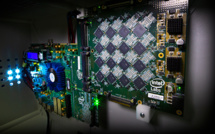 One of Intel's Nahuku boards, each of which contains 8 to 32 Intel Loihi neuromorphic chips, shown here interfaced to an Intel Arria 10 FPGA development kit. Intel's latest neuromorphic system, Poihoiki Beach, annuounced in July 2019, is made up of multiple Nahuku boards and contains 64 Loihi chips. Pohoiki Beach was introduced in July 2019. (Credit: Tim Herman/Intel Corporation)